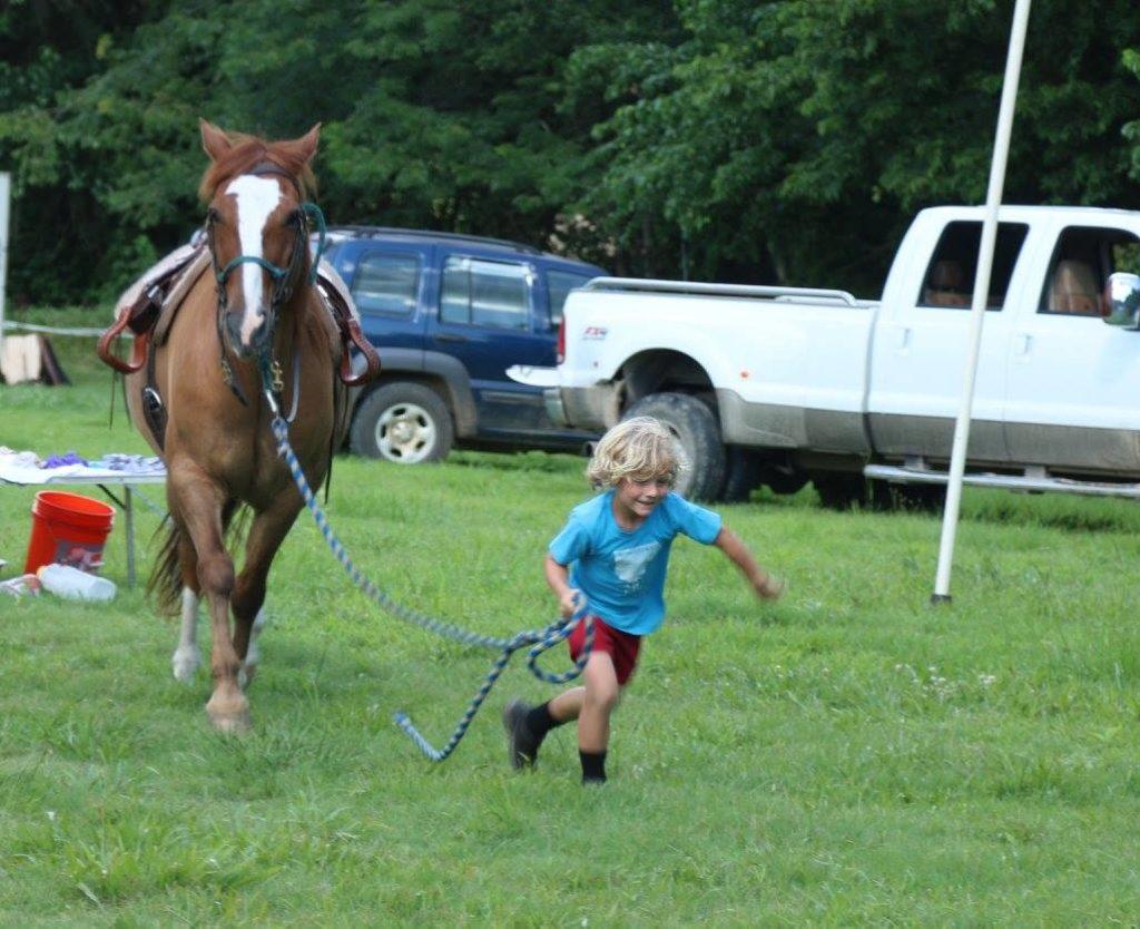 Dalton leading his horse at a run